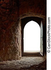 Passage of an old castle, open door