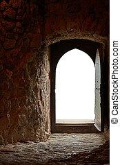 Passage of an old castle, open door
