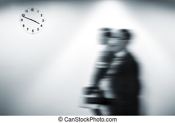 Passage of time concept. Blurred image of people going about...