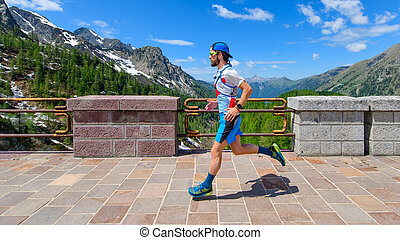 Passage on a mountain dam by an ultra trail athlete