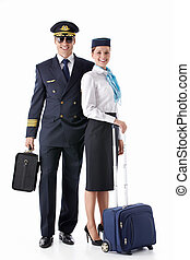 Passage - The pilot and stewardess with a suitcase on a...