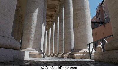Passage through columns St. Peter's Square, Vatican city, Italy