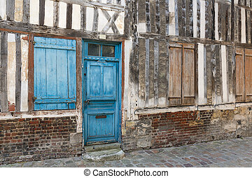Passage with medieval houses downtown in Honfleur, France