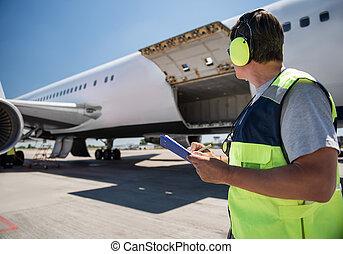passager, ouvrier, aéroport, avion, regarder, quoique, presse-papiers, tenir stylo