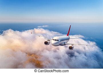 passagier, wolken, op, vliegen, ondergaande zon , vliegtuig