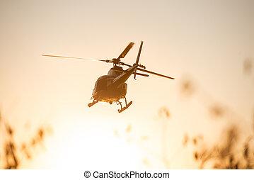 Passanger Helicopter flying in sunset sky