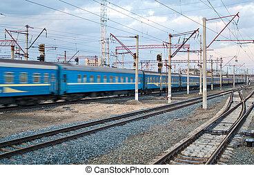 Passanger train passing the station Darnytsia, Kyiv, Ukraine