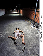 Passed out - Asian girl lies in an empty street