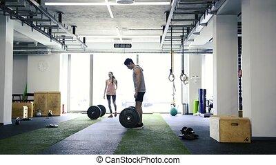 passen, jong paar, in, gym, het tilen, zware, barbell.