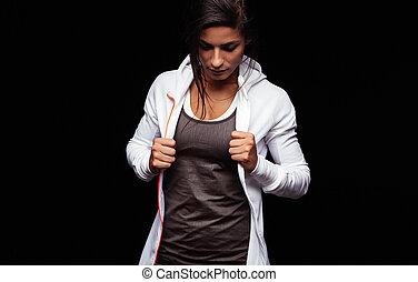 passen, jonge vrouw , in, sportkleding