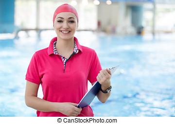 passen, vrouwlijk, zwemmen, trainer, met, tablet, op, de, pool
