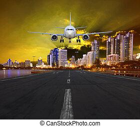 passenger air plane landing in urba