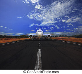 passenger air plane running on airport runway with beautiful...