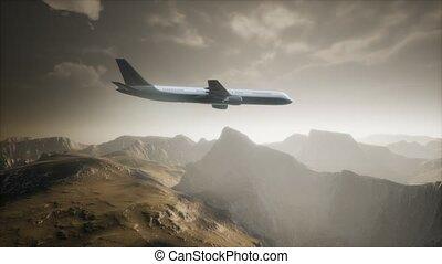 Passenger aircraft over mountain landscape