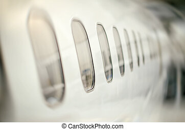 Passenger aircraft windows. View from outside.