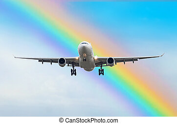 Passenger airplane arrives landing in the rainbow at the airport.