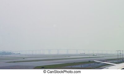 Passenger airplane driving on runway for taking off in airport terminal. Aircraft moving on runway after landing in departure airport terminal.