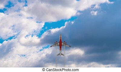 Contemporary passenger airplane flies across picturesque sky with floating white clouds on sunny day bottom view merge video
