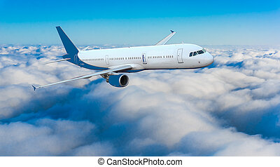 Passenger airplane flying above dramatic clouds