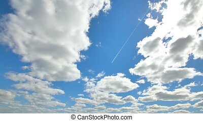 Passenger airplane flying above sky with clouds in shape