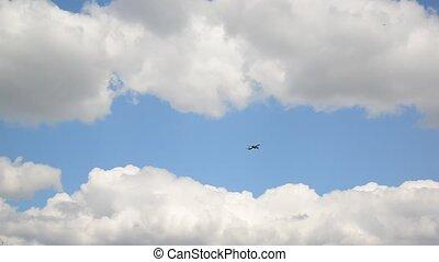 passenger airplane flying through the sky - A passenger...