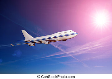 passenger airplane in the clouds at sunset or dawn. travel by air transport. flying to the top of the airliner. nobody