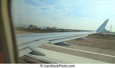 passenger airplane is gaining speed on the runway