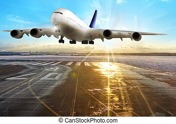 Passenger airplane landing on runway in airport. Evening.