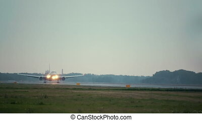 Passenger airplane landing on runway in airport