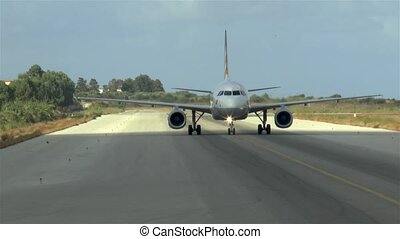 Commercial aircraft taxing to the tarmac after landing.