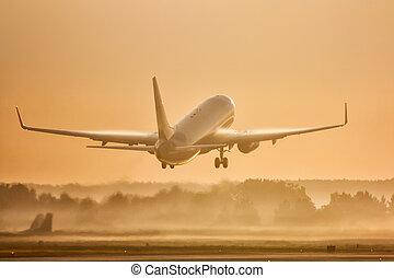 Passenger airplane take off in morning fog