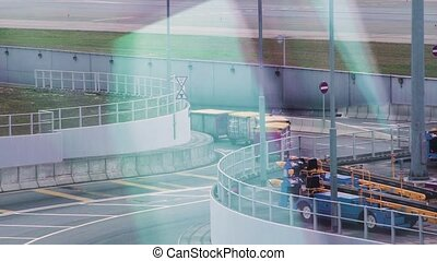 Passenger baggage for loading in aircraft in departure airport terminal. Transportation luggage for unloading after landing passenger airplane in airport terminal.