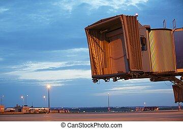 Passenger Boarding Bridge - Evening at the airport -...