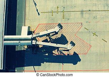 Passenger boarding bridges - Aerial view on the passenger...