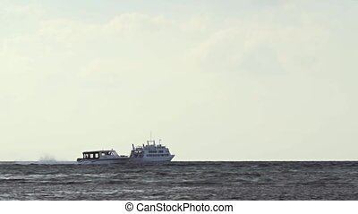Passenger Boat Cruises Past at High Speed in the Maldives