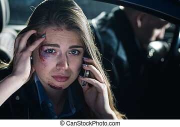 Passenger calling for a help after a car crash