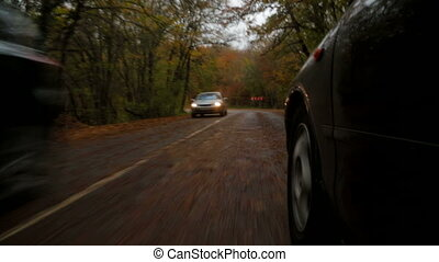 Passenger Car Driving Along Winding Road In Autumn Forest -...