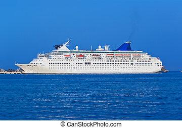 Passenger cruise ship at sea - transportation background
