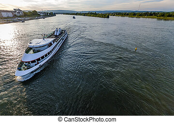 Passenger cruise ship on the Rhine river in Mainz, Germany on a summer evening.