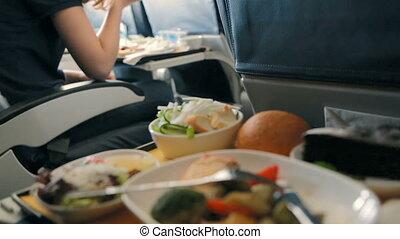 Passenger eats food on Board the plane