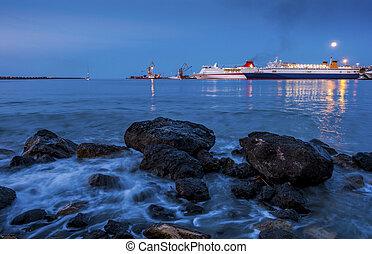 ?Passenger ferries in the port at dusk at sunset, Heraklion, Crete, Greece.