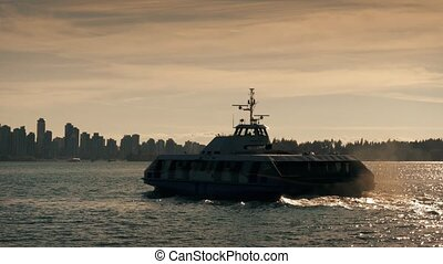 Passenger Ferry Crossing To City - Ferry travels past...