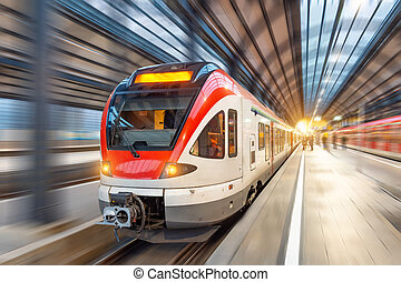 Passenger high speed train with motion blur in station.