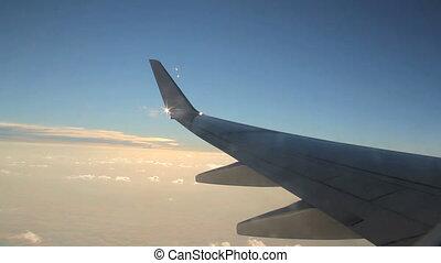 Passenger Jet 1 - Sun breaks through from behind the wingtip...