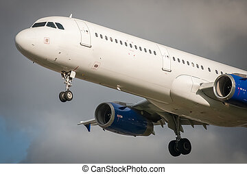 closeup of an unmarked passenger aircraft about to land
