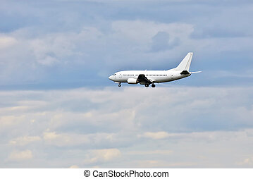 passenger jet flies in for a landing