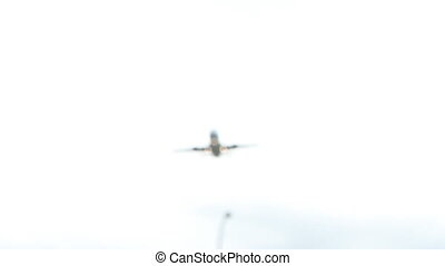 Passenger jet flyover. - Passenger jet flies over on final...