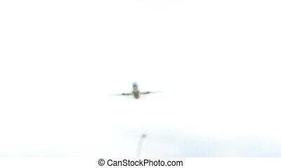 Passenger jet flyover.