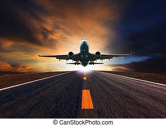passenger jet plane flying over airport runway against beautiful