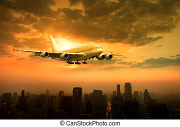 passenger jet plane flying over urban scene against beautiful sun set sky use for air transport and traveling theme